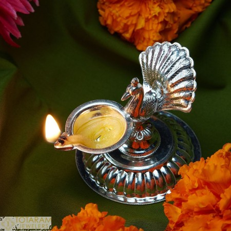 Peacock Silver Diya for Pooja - 1-S27 - Buy this Latest Indian Gold Jewelry Design in 21.200 Grams for a low price of  $94.37
